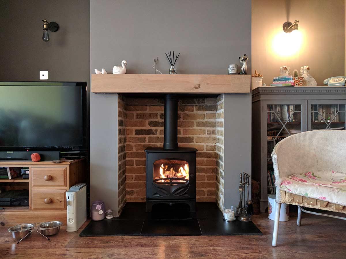 Oak Beam Above A Brick Slip Fireplace Chamber